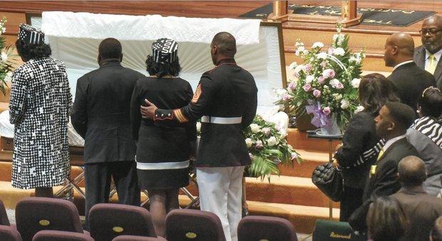 Family members pay their last respects to Alicia Rasin before her funeral service last Saturday at Saint Paul's Baptist Church.