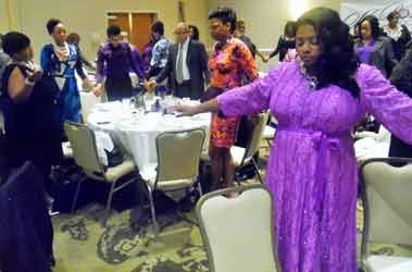 Honorees joined hands and prayed with event attendees at the second annual She Rose Awards, during Domestic Violence Awareness month.