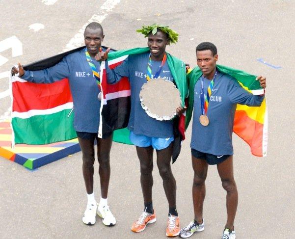 The top three finishers (L to R) Geoffrey Kamworor, Stanley Biwott (champion), and Lelisa Desisa