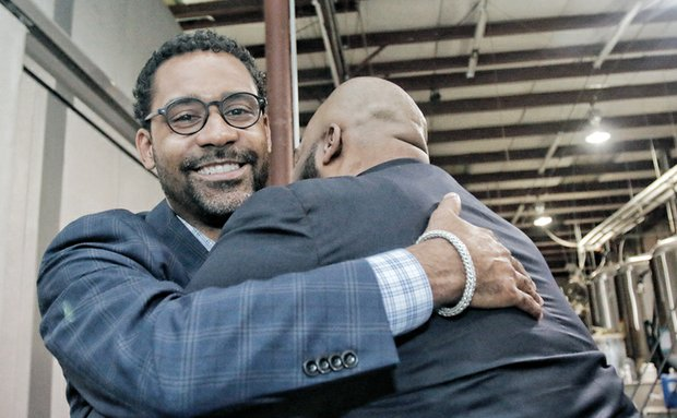 The Rev. Roscoe D. Cooper III, left, receives congratulations from Henrico Delegate Lamont Bagby after Tuesday's election results showed both men were victorious. Rev. Cooper won a close race to represent the Fairfield District on the Henrico School Board. Delegate Bagby, who won re-election Tuesday to the General Assembly, previously held the Fairfield seat.