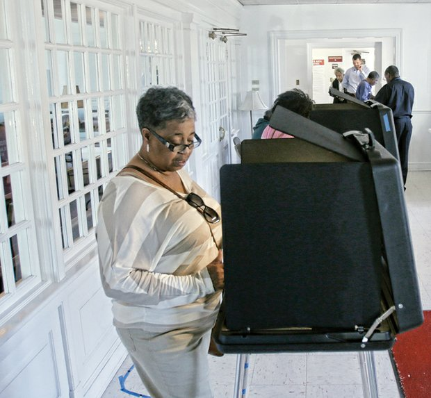 Sheila Anderson casts her ballot Tuesday at her polling place at Thirty-first Street Baptist Church in the East End.