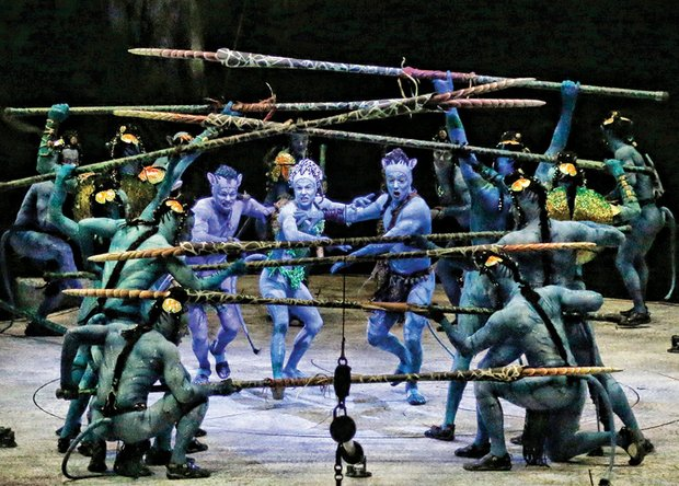 "Colorfully costumed artists, center from left, Guillaume Paquin (Entu), Giulia Piolanti (Tsyal) and Gabriel Christo (Ralu) go through final rehearsals last week in Shreveport, La., for ""TORUK – The Final Flight,"" the latest Cirque du Soleil production. The show, inspired by the award-winning movie ""AVATAR,"" will run the Friday, Nov. 27, through Sunday, Nov. 29 at Richmond Coliseum."