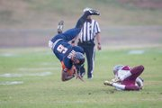 Virginia State University quarterback Tarian Ayres is upended by a Virginia Union University defender during Saturday's 28-27 win by the Panthers over the host Trojans at Rogers Stadium in Ettrick.
