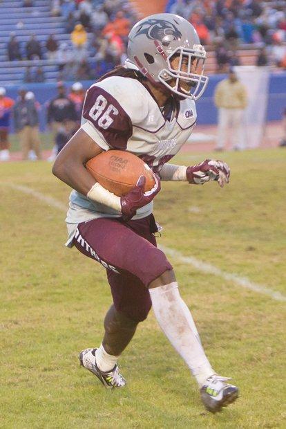 Virginia Union University wide receiver Chazton McKenzie looks for running room during Saturday's big game against Virginia State University.