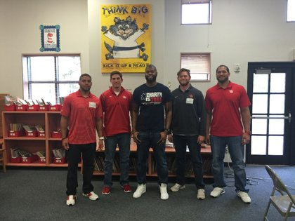 Wade Smith,  with current and former NFL/CFL players, a former USA Track and Field member as well as student athletes from the University of Houston football team preparing to read to students at C. Martinez Elementary in Houston, Texas