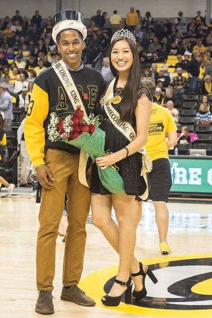 VCU homecoming royalty // Lawrence Cooper and Amy Chong are all smiles after they were presented as the Virginia Commonwealth University 2015 Homecoming King and Queen last Friday at the Rams' game against Prairie View A&M University at the Siegel Center. The Rams trounced the Panthers 75-50. Last weekend's homecoming festivities at VCU included a parade, alumni and student leader networking brunch, a step show and a VCU women's basketball game won by the Lady Rams, 73-42, over Coppin State University.