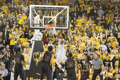 Virginia Commonwealth University forward Justin Tillman takes it to the hoop to score in the game last Friday against Prairie View A&M University at the Siegel Center. The Rams won 75-50.
