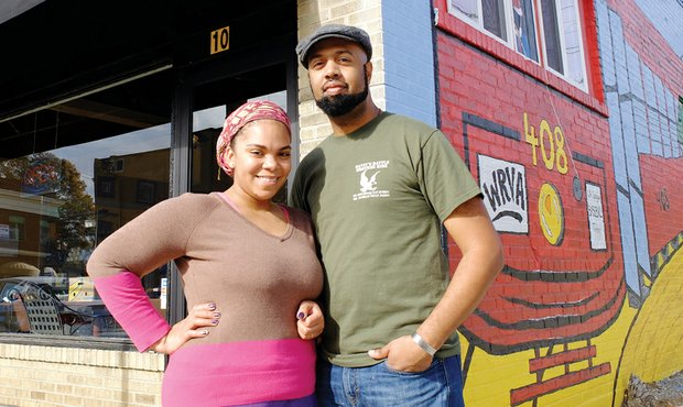 Kirsa and Sean Crippen stand outside the Streetcar Café Saturday as they prepare to close up their coffee shop for good. Location: 10 E. Brookland Park Blvd. in North Side.