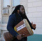 David Fakunle, Ph.d student at Johns Hopkins University sang and beat his drum at the expansion announcement.
