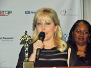Dr. Dawn Lindsay, president of Anne Arundel Community College, accepts the Excellence in Academic Leadership award.