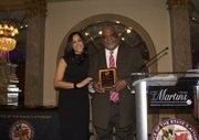Baltimore City Sheriff John W. Anderson receives this year's Shield Award from SAO at the first Winter Solstice 2015