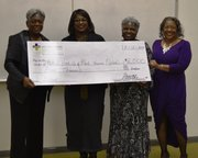Leslie Newbon, Silver Cross Healthy Communities Commission a $5,000 check to members of the National Hook-Up of Black Women for their new reading lab during National Hook-Up Donors Appreciations event on Saturday. Pictured left to right -Deborah Summers - National President, Leslie Newbon - Silver Cross, Debra Upshaw - NHBW Joliet Chapter President, Geraldine Littlepage NHBW 1st Vice President.
