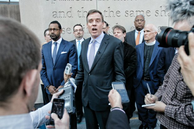Above, U.S. Sen. Mark Warner, backed by faith leaders from the Muslim, Christian and Jewish communities, calls for religious tolerance at a news conference last Friday in Richmond.