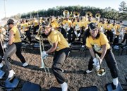 The Highland Springs Marching Battalion swings into action at the ceremony celebrating the state's No. 1 football team. The band played Tuesday as the champions paraded from the school to Kreiter Stadium and the cheers of jubilant students and fans.
