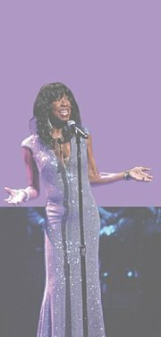 Natalie Cole sings at the Apollo Theater's 80th anniversary gala in 2012. In 1992 she donated $100,000 to the theater to former New York City Mayor David Dinkins and Apollo Chairman Percy Sutton.