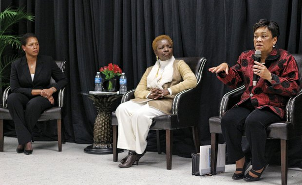 Mayor Toni Harp, right, of New Haven, Conn., speaks at a panel discussion Tuesday as Mayor Tyus Byrd, left, of Parma, Mo., and former Miami Gardens, Fla., Mayor Shirley Gibson listen at Summit Construction & Environmental Services on South Side.