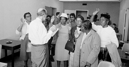 A courthouse official administers the oath to voter registration applicants in Montgomery, Alabama, Feb. 9, 1965. Dr. Martin Luther King Jr. led a group of almost 200 African Americans to the registrar's office in a voter drive.