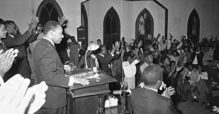 Dr. Martin Luther King Jr., who was attacked when he registered at a White hotel, says in Selma, Alabama, Jan. 19, 1965, African Americans will march on the Dallas County Courthouse again and that those seeking to register to vote will use the front door. African Americans who sought to register were forced to line up in an alley beside the courthouse.