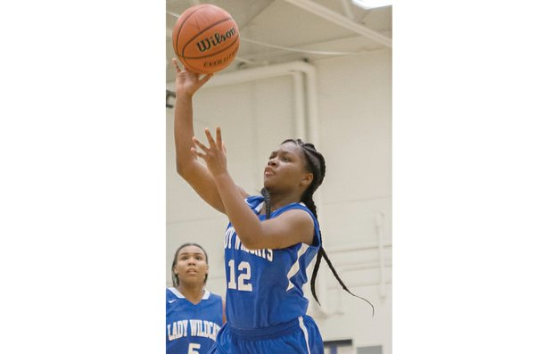 Armstrong High School starting guard Rashaundra Thomas shoots for the hoop during a recent practice. With her shooting skills, Thomas and the team hope to head to the 3A state tournament.