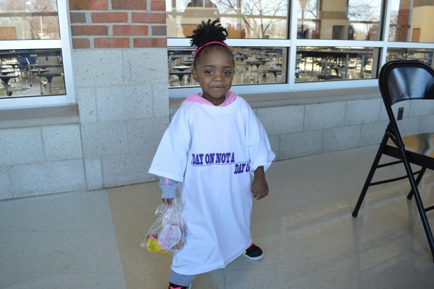 """Journee, 2, shows her support for the MLK Day """"Day on, not a day off"""" service event."""