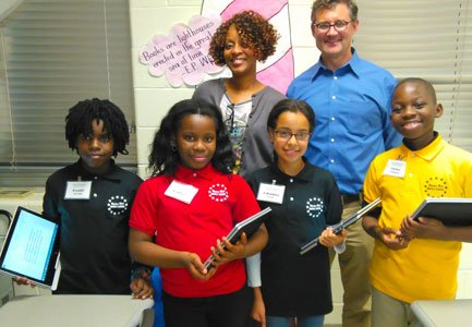For eleven-year-old sixth-graders Avante Morgan, Temitope Peters, Victor Chongwa and 10-year old Rianna Davis, using their school-issued HP Elitebook Revolve ...