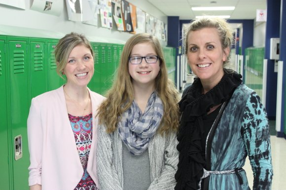 Romeoville High School freshman Corinne Doty and Jane Addams Middle School 7th grader Emily McKeever received perfect scores on the ...
