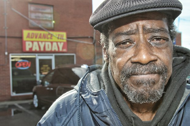 Donald Garrett stands outside the Advance 'Til Payday loan agency, 4311 Nine Mile Road, where he borrowed $100. The loan ended up costing him $320 in fees he could not afford on his fixed income.
