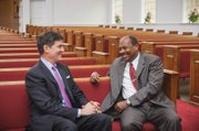 Dr. Reginald F. Davis, right, pastor of First Baptist Church, shares a moment with Mitchell B. Reiss, president and CEO of the Colonial Williamsburg Foundation, inside the historic African-American church in Williamsburg.