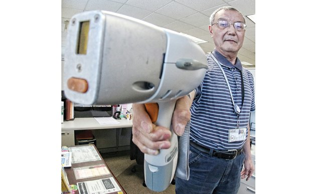 Inspector Ben Yan shows how the lead detector instrument works during a demonstration Wednesday in his office at the Richmond City Health District.