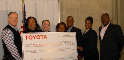 Michael Rouse, vice president of diversity, philanthropy and community affairs for Toyota Motors North America; Alva P. Adams-Mason, director of African American business strategy for Toyota; Major Gene A. Hogg, area commander of The Salvation Army of Central Maryland; comedienne, Meshelle; Avery Cook; Lt. Kimberly Harvey from The Salvation Army; and Tim Hale celebrate the presentation of Toyota's $15,000 donation to The Salvation Army of Central Maryland.
