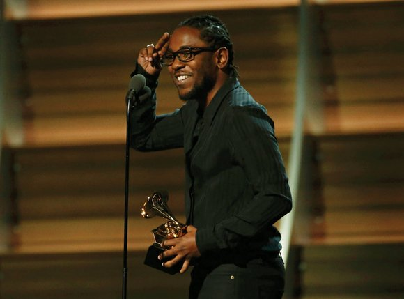 Hip-hop ruled the stage Monday night at the Grammy Awards in performances that put racial tension back in the national ...