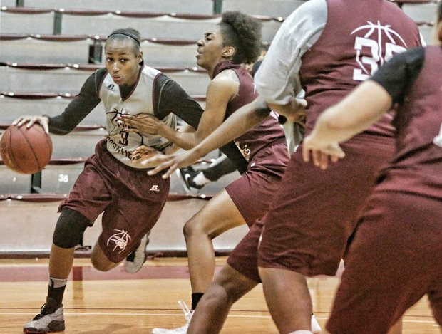 Powerhouse and record-breaker Kiana Johnson drives to the basket during a practice game at Virginia Union University.