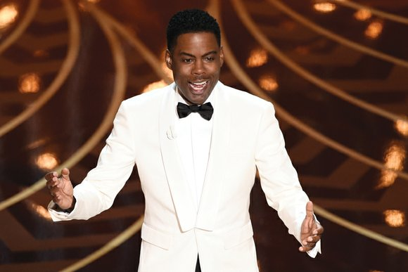 Comedian Chris Rock launched his return stint as Oscar host Sunday by immediately and unabashedly confronting the racially charged elephant ...