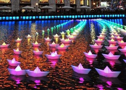 You are at Baltimore's Inner Harbor, and spot a giant lotus flower sculpture, which lights up the water. You walk ...