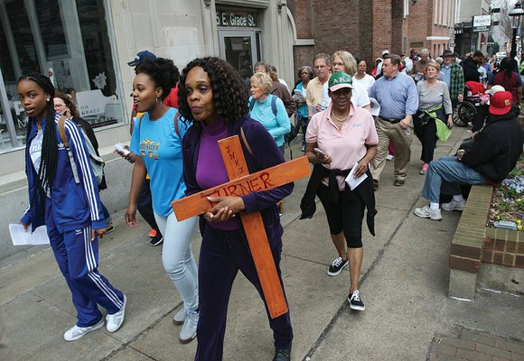 Evangelist Michelle Turner of All Saints Episcopal Church in Henrico County held a wooden cross that she made as she ...