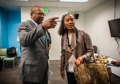 Broderick Johnson meets actress and producer Sonja Sohn at the Center for Urban Families in Baltimore. Broderick Johnson is Chair of the My Brother's Keeper Task Force. MBK is President Obama's initiative to expand opportunity for young men of color