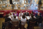 President Obama talks during an informal lunch last week at a Washington restaurant with top aides and four individuals who previously served time in prison, including Kemba Smith who grew up in Henrico County.