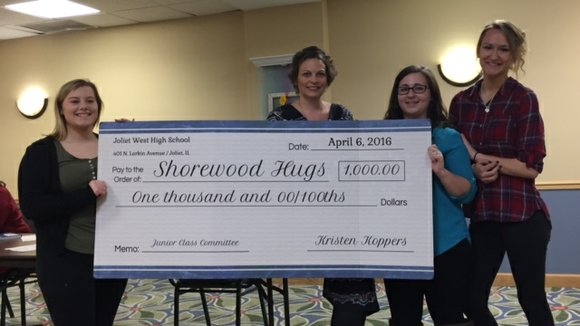 The juniors held a benefit for the organization which received a check for $1,000.