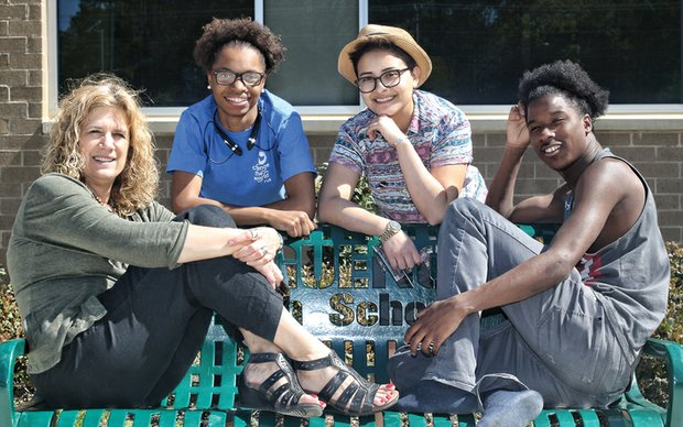 Dr. Natalie May, left, holds an impromptu meeting with three Change the World RVA students. From left, they are Marshé Turner, Leo Reyes and Vincente Johnson. Location: Huguenot High School in South Side.