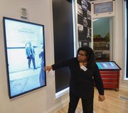 Visitors get a first look and touch of the new interactive displays installed at the Black History Museum Cultural Center of Virginia during a media tour last week. The screens are positioned throughout the museum, which also features a 55-inch touch table.
