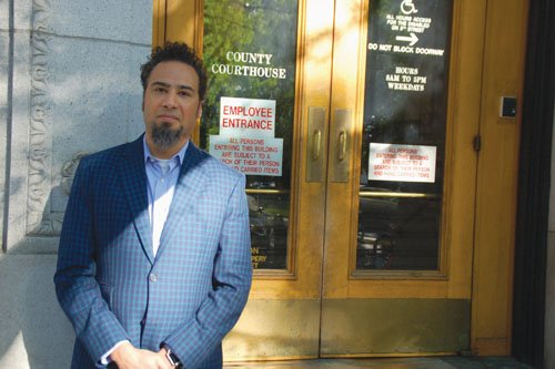 Outside the Multnomah County Courthouse, David Rogers, executive director of the American Civil Liberties Union of Oregon, gives attention to a new ACLU Oregon report showing how uncontested district attorney races are a factor in tapping down criminal justice reforms.