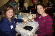 Sisters Paula Dunn of Linthicum Heights and Robin Hein of Pasadena share tea cups that once belonged to their mother