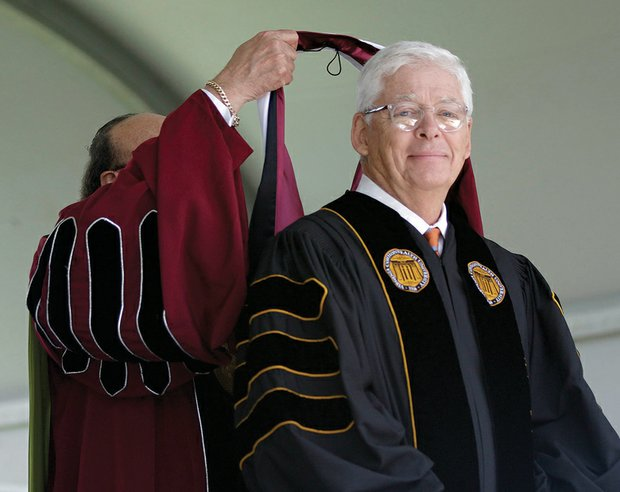 Dr. Perkins hoods businessman and VUU supporter William A. Royall Jr. with an honorary doctorate.