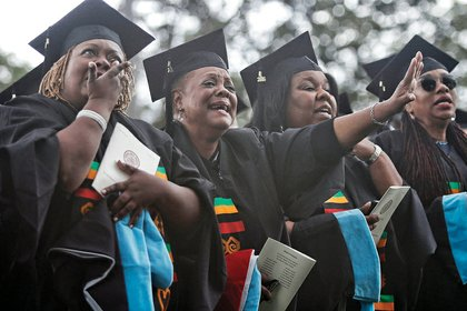 Theology school graduates, from left, Donna Cosby, Sheila Dent, Rona Evans and Alice Freeman shed tears of joy as the VUU choir sings.