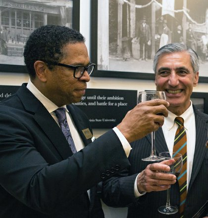Dr. Monroe E. Harris Jr. and Hossein Sadid, BHM board members, toast to a successful opening. Board Co-chair Bessida Cauthorne White and Chairwoman Marilyn H. West helped lead the multimillion-dollar project. Elijah Crawley, 12, an Elko Middle School student and son of museum director Tasha Chambers, learns firsthand from former Gov. L. Douglas Wilder.