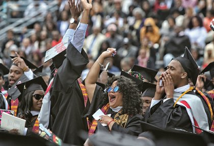 VUU graduates wave to family and friends at Hovey Field.