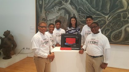 Pictured are middle school boys from Houston's KIPP Academy with Verizon South Central Market President Krista Bourne. Photo credit: Earlie Hudnall, TSU photographer
