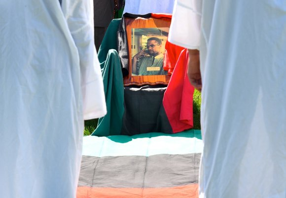 At the Shabazz Memorial and Educational Center, there was birthday cake. Droves of activists gathered at his grave site in ...