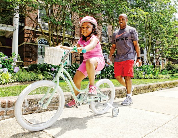 Cruising // Under the watchful eye of her father, Tommy Davis, young Luci cruises on her bicycle along the 500 block of South Davis Avenue during a sunny spell on Memorial Day weekend in the West End. Please see additional holiday photos, Page B3.