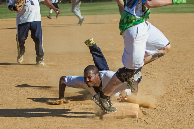 Kevin Rather of the Richmond-based Cooke's-Allen softball team slides to tag the bag to get a runner out during last Saturday's game against BTA at the SoftballNation N.I.T. Beast of the East tournament.